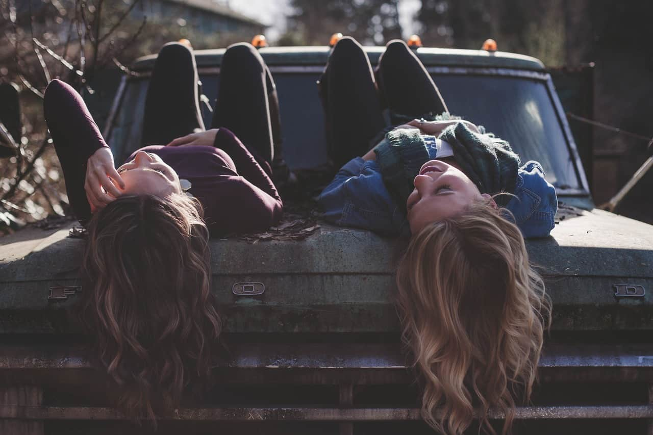 National curly-hair day,                 girls lying classic car