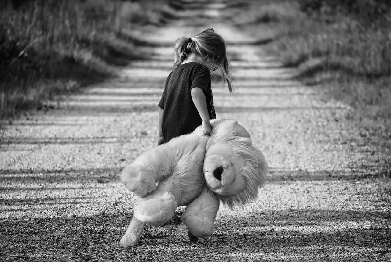 National girl-child day,                 girl walking teddy bear