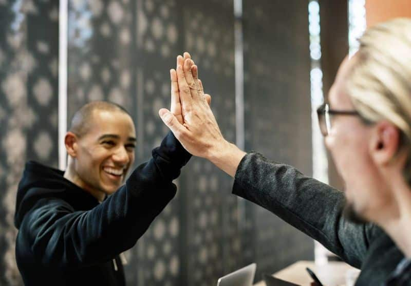 National high-five day,                 american colleague communication