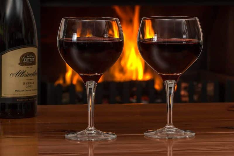 wine wine glasses log fire